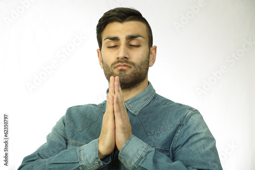 Praying man, a horizontal portrait