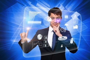 Thinking businessman touching interface