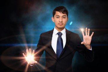 Serious businessman touching lights