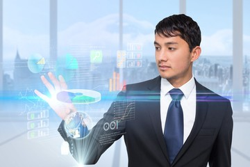 Asian businessman touching interface