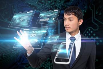 Asian businessman touching interfaces