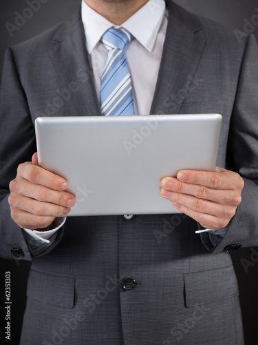 Businessperson Holding Digital Tablet In Hand