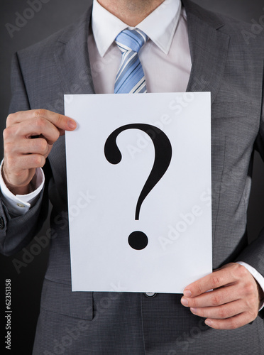 Businessperson With A Question Mark Sign