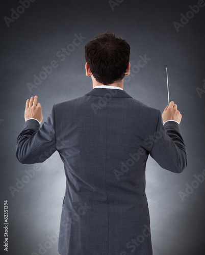 Orchestra Conductor With Baton