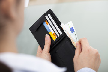 Businessperson With Open Wallet