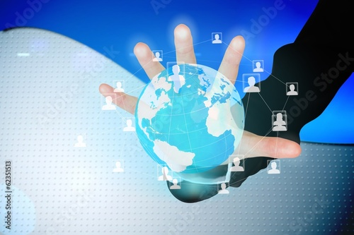 Hand touching global business interface
