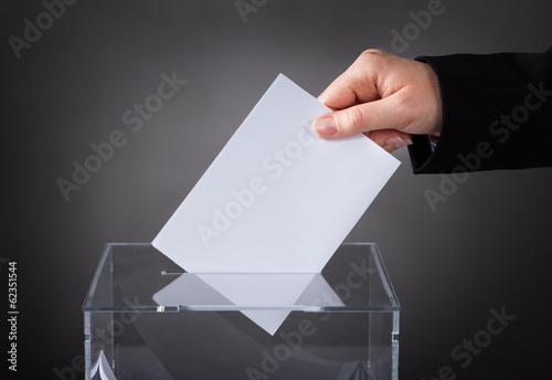 Hand Putting Ballot In Box