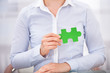 Businessperson With Green Puzzle