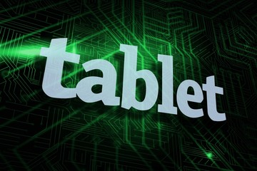 Tablet against green and black circuit board