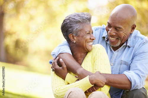 Senior Couple Relaxing In Autumn Landscape - 62351982