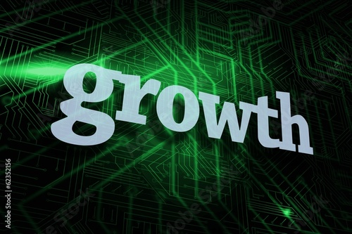 Growth against green and black circuit board