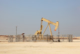 Oil pump jack in the desert of Bahrain, Middle East