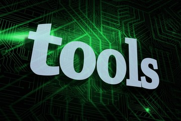 Tools against green and black circuit board