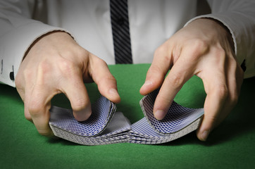 hands shuffling cards casino