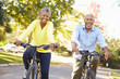 Senior Couple On Cycle Ride In Countryside - 62352599