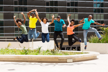 group of african college students jumping