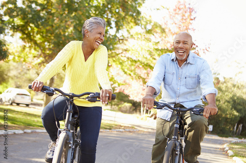 Senior Couple On Cycle Ride In Countryside - 62352582