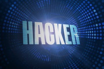 Hacker against futuristic dotted blue and black background