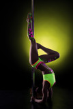 Flexible girl with UV makeup dancing in studio