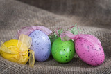 Decorative Easter eggs on burlap background