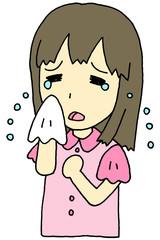 涙を拭く女性