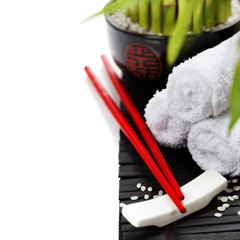 Chopsticks and a lucky bamboo plant