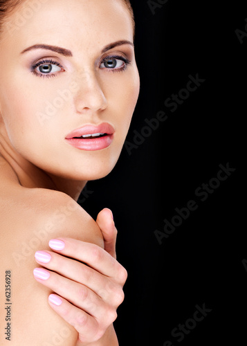 Beautiful   face of the adult woman with fresh skin