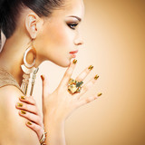 Profile portrait of the fashion woman with beautiful golden mani