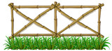 A bamboo fence with grass