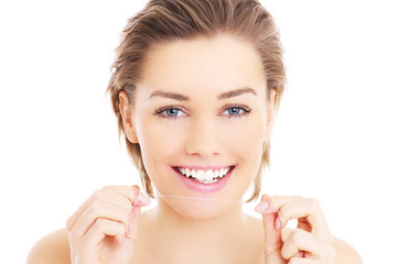 Woman with teeth floss