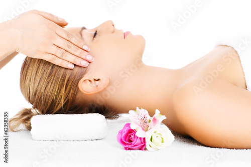Woman having head massage - 62358338