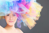 Woman in a rainbow hat