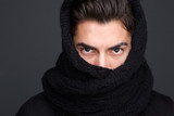Male fashion model scarf covered face