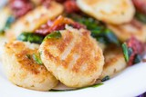 Fried potato gnocchi with sauce of dried tomatoes, spinach