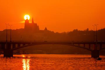 A beautiful sunset over silhouette of Prague Castle