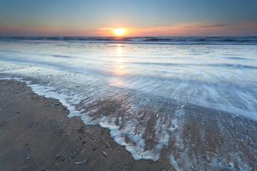 gold sunset over North sea beach