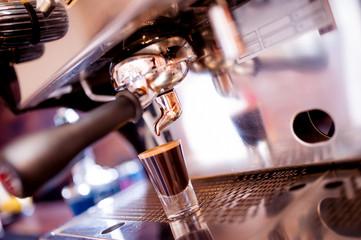 espresso machine making special coffee in small cup