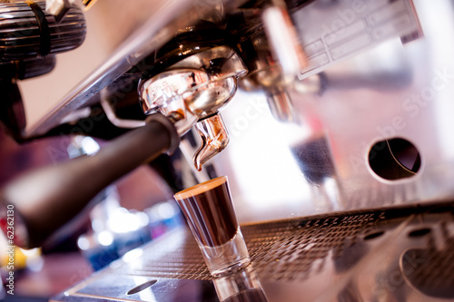 espresso machine making special coffee in small cup