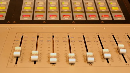 Studio sound control panel sliders and lights