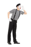Full length portrait of a mime artist shouting