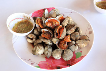 Boiled cockles or scallop