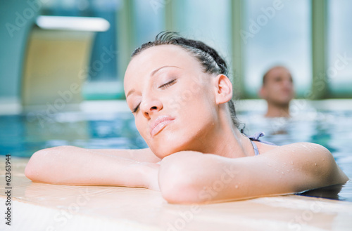 woman relaxing swimming pool