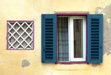 Mediterranean villa window with open shutters