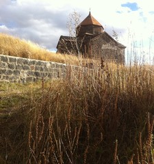 old Armenian monastery with grass and brick wall