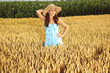young beautiful woman in field of wheat