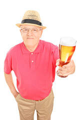 Senior gentleman holding a pint of beer