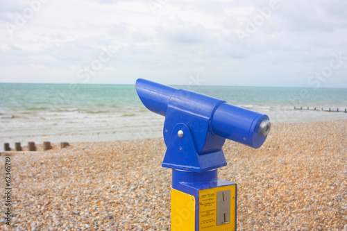 blue viewfinder telescope at seaside beach