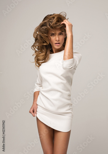 Sexy model posing in white dress