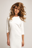 Beautiful model posing in white dress - 62366141