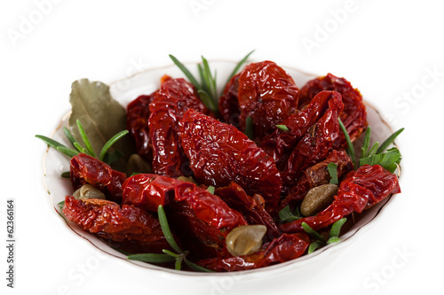 Dried tomatoes with herbs